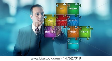 Experienced businessman with determined facial expression is touching a puzzle piece inscribed with the word RISK. Business concept for risk assessment hazard analysis and probability assessment.