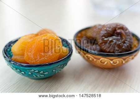 Orange dried apricots and figs on a plate