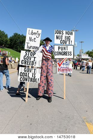 SAINT LOUIS, MISSOURI - SEPTEMBER 12: Man dressed in Patriotic clothing holding signs at rally of the Tea Party Patriots in Downtown Saint Louis under the Arch, on September 12, 2010
