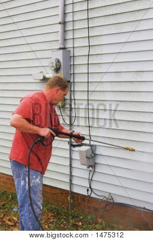 Man Washing House