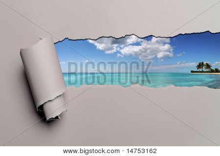 Torn paper with Caribbean island in opening background