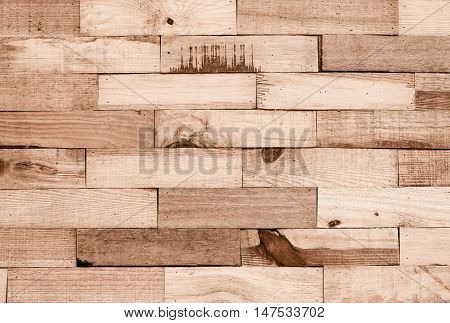 Wood plank wall arranged as a brick wall pattern for design and decoration