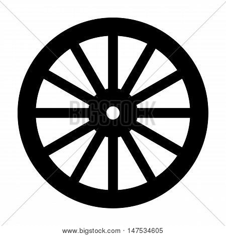A typical wheel from a western covered wagon in silhouette