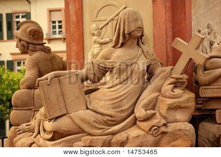 Goddies Of Statue Of Minerva On The Old Bridge In Heidelberg, Germany