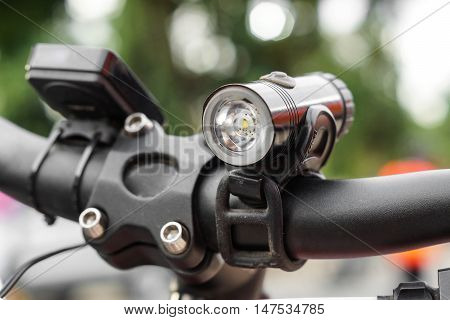 Bicycle front light for riding at night installed on a handlebar