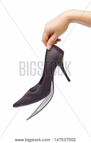 Female hand holding broken high heel shoes