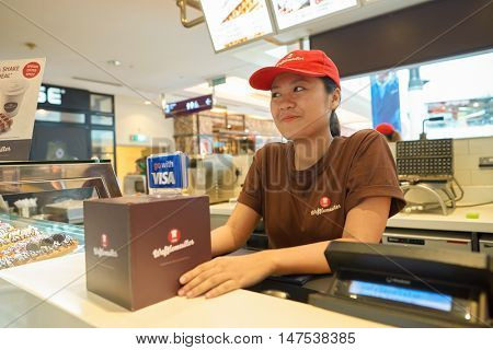 KUALA LUMPUR, MALAYSIA - MAY 09, 2016: indoor portrait of a woman at Suria KLCC. Suria KLCC is located in the Kuala Lumpur City Centre district.