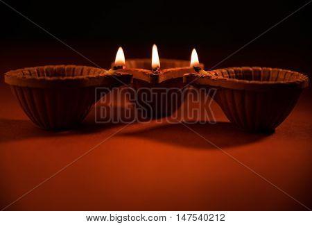 beautiful diwali diya or oil lamp or lighting, selective focus