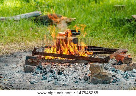 kettle tea pot trip. summer camping. fire
