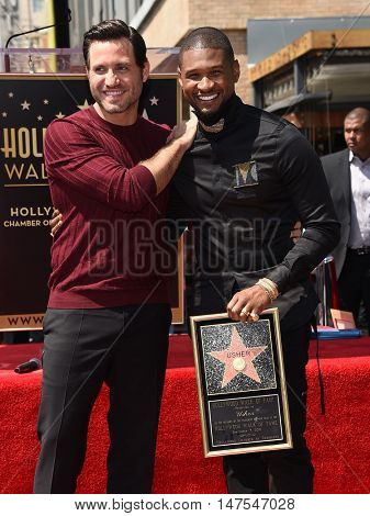 LOS ANGELES - SEP 07:  Edgar Ramirez and Usher arrives to the Walk of Fame honors Usher on September 07, 2016 in Hollywood, CA