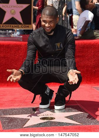 LOS ANGELES - SEP 07:  Usher arrives to the Walk of Fame honors Usher on September 07, 2016 in Hollywood, CA