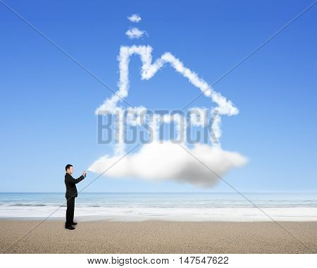 Businessman Spraying House Shape Cloud Paint
