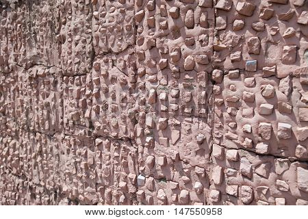TAGANROG RUSSIA - June 24 2016: The texture stuck by small stones on a pink background