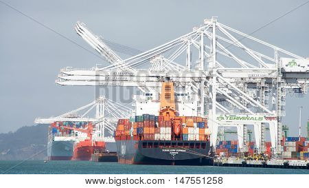 Oakland CA - September 12 2016: The Port of Oakland loads and discharges more then 99 percent of containerized goods moving through Northern California the nations fourth largest metropolitan area.