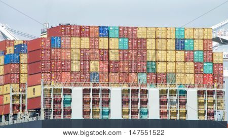 Oakland CA - September 12 2016: Cargo Ship MSC ARIANE with thousands of shipping containers organized and placed algorithmically for efficient transport. Thousands of cargo carriers ply the worlds seas and oceans each year.