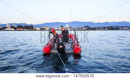 Sochi, Russia - NOVEMBER 8, 2014: work of Russian Emergency Situationsa Ministry, Rescue Marine Service towing a broken boat from the sea. Curfew in border area