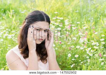 Teen girl thinks about the problems of the outside