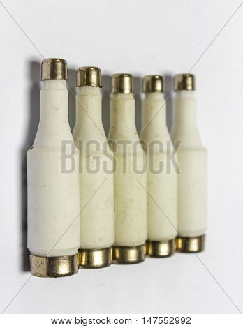 Old AC fuse on white background. close-up