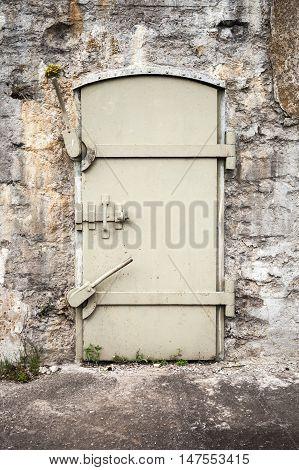 Closed Massive Metal Door In Old Wall