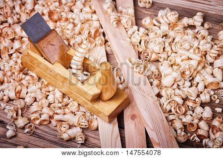 Wooden planer, a natural building material, handcrafted wood, ancient hand tools, carrying out carpentry, joinery tools, wood sawdust