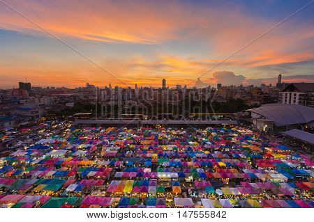 Top view multiple colors weekend market roof top with beautiful sunset sky background