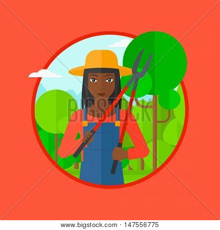 African-american woman working in the garden with pruner. A gardener is going to trim branches of a tree. Gardener pruning a tree. Vector flat design illustration in the circle isolated on background