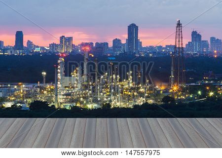 Open wooden floor, Oil refinery with city downtown background and twilight sky background