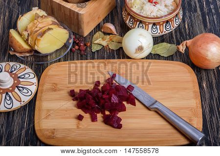 Russian vinaigrette ingredients: potatoes, beets, carrots, canned peas, pickled cabbage sunflower oil and dill