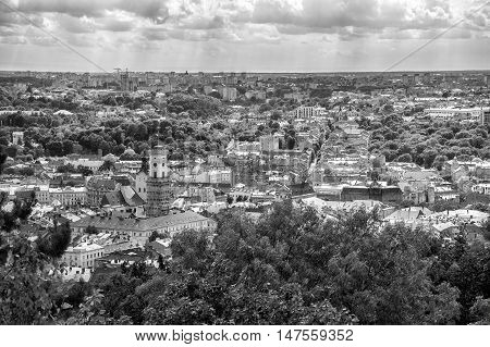 Lviv Ukraine old city vintage toned top view panorama with houses roofs. Sity hall tower tower. Black and white
