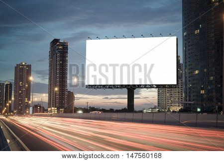 blank billboard on the highway blank billboard during the twilight light blank billboard in city background. With clipping path on screen.- can be used for display your products or promotional