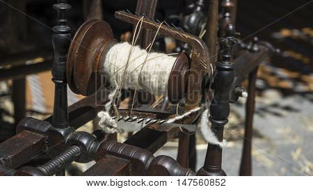 Vintage, traditional spinning wheel for wool yarn, craft ancient instrument