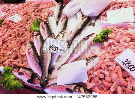Venetian fish market - fish and prawns. The Rialto fish market is located alongside the Grand Canal near the Rialto Bridge - Venice, Italy