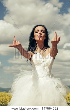Pretty Wedding Girl On Blue Sky With Middle Finger