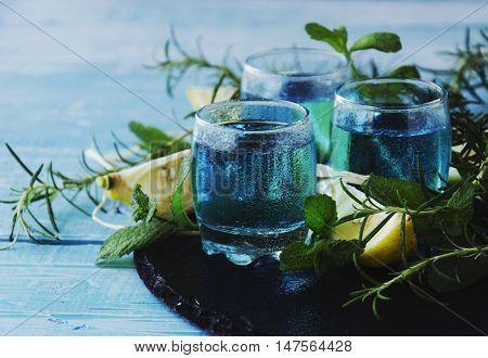Blue Curacao Liqueur Or Sambuca With Lemon