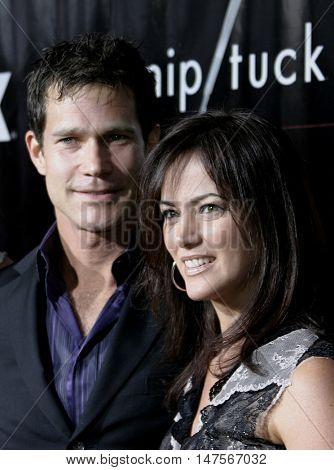 Joanna Going and Dylan Walsh at the FX Networks NIP/TUCK 3rd Season premiere held at the El Capitan Theatre in Hollywood, USA on September 10, 2005.
