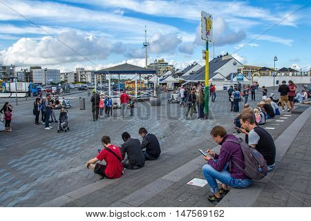 The Hague the Netherlands - September 17 2016: Pokémon GO hot spot at Kijkduin The Hague the Netherlands