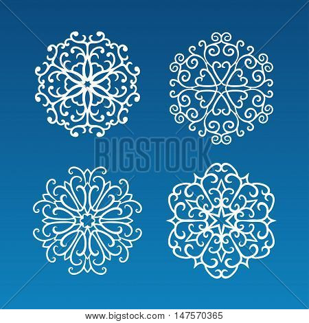 Vector set of four hand drawn white curly snowflakes on blue background