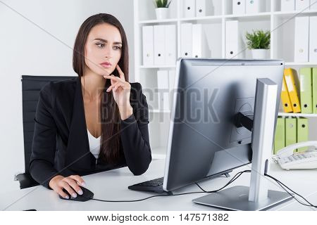 Pensive Business Lady And Her Computer