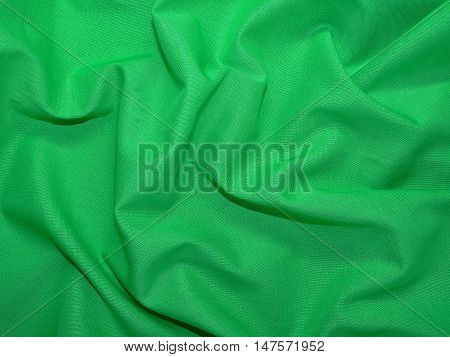 texture of green fabric, rich color laid in the crease