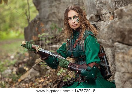 Elf Woman In Green Leather Armor With The Dagger