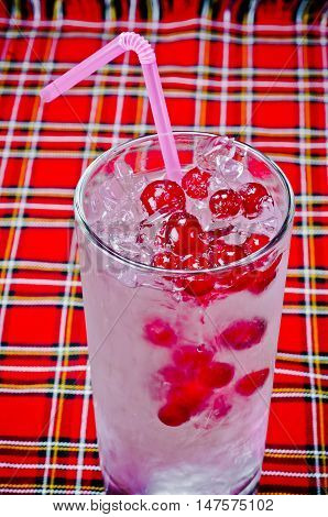 delicious cold refreshing summer cocktail with ice and red berries for the menu in restaurants bars cafes clubs