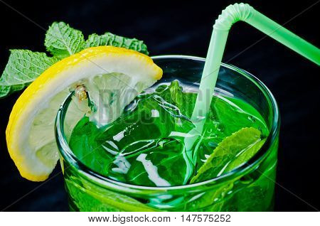 beautifull decorated motijo with ice apple lime and mint is served in the bar restaurant club
