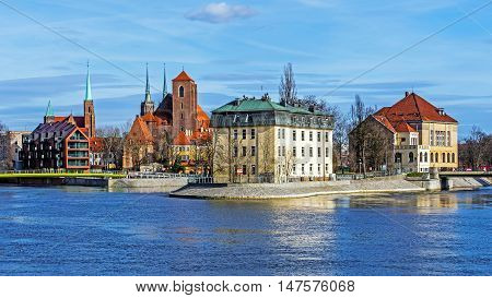 WROCLAW, POLAND - MARCH 19, 2016: Overall view on Sand Island (Wyspa Piasek) on the Oder River in Wroclaw Poland. In the center the Church of the Blessed Virgin Mary.