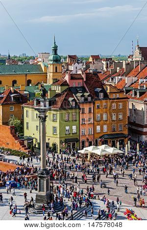WARSAW, POLAND - MAY 03, 2016: The Castle Square with Sigismund's Column in the middle and the Old Town skyline. Place is the main tourist attraction of the city always crowded with tourists.