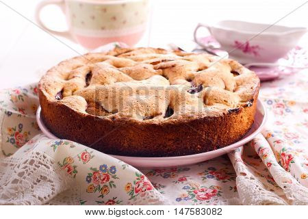 Fruit sponge cake on plate on table