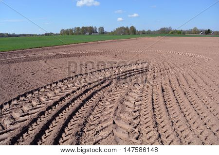Freshly plowed earth in rural area on sunny summer day