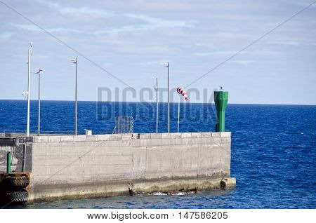 Seascape with pier on sunny day Canary islands Spain