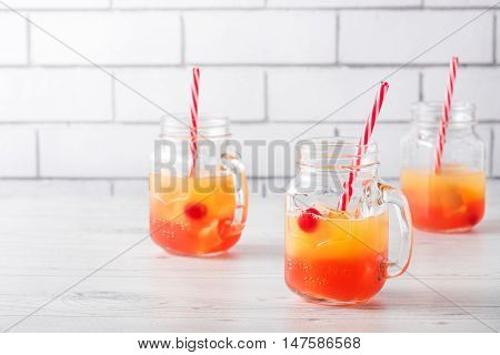 Tequila Sunrise Cocktails In Glass Jar