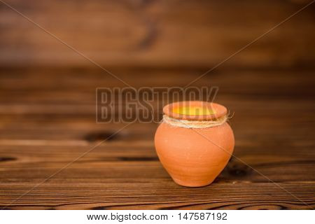 Concept Greeting Card Of Ceramic Pot On Wooden Background, Art Design, Copy Space, Toned Style, Clos