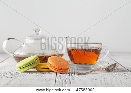 Traditional French Colored Macarons With Cup Of Tea